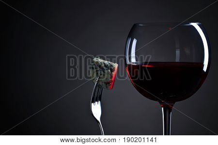 Blue Cheese And Glass Of Red Wine .