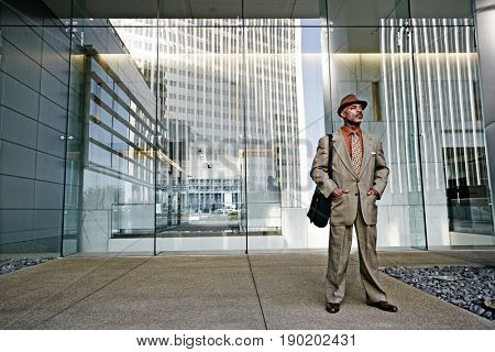 Black businessman standing outside office