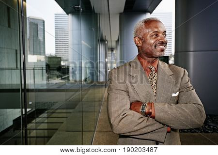 Black businessman smiling outdoors
