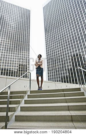 African American businesswoman standing on city steps