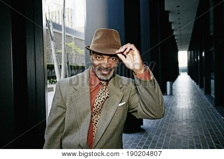 Black businessman tipping his hat