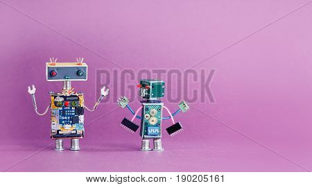 Pair funny robots characters on pink violet background. 4 industrial revolution concept. Cyber toys hand up. Copy space photo