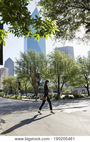 Caucasian woman walking on city street, Dallas, Texas, United States