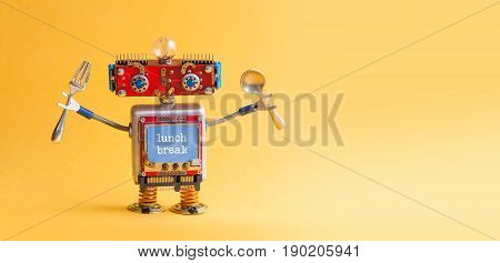 Lunch break concept. Funny robotic toy fork spoon in arms. Retro style cyborg monitor screen with text quote. Yellow background, copy space.