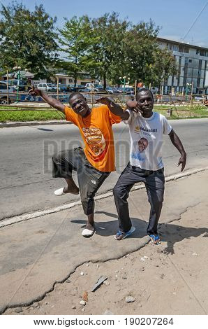 ABIDJAN, IVORY COAST, AFRICA. May 3, 2013. Two young African man hamming  joking fooling around. African people stock image.