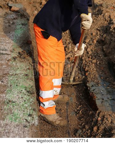 Worker With The Orange Pants In The Trench