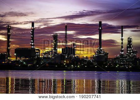 Oil refinery at twilightChao Phraya river Thailand