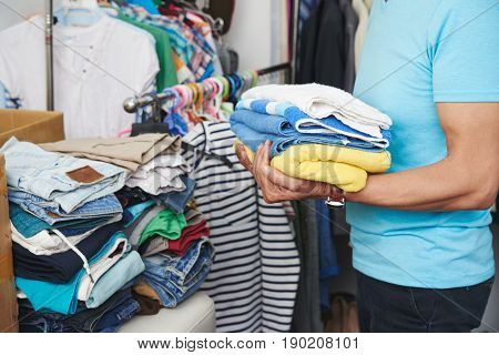 Close-up image of man sorting clothes after washing them