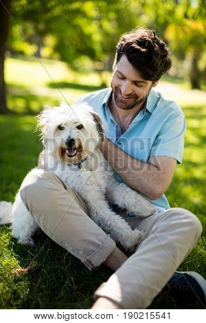 Man with dog in park on sunny a day
