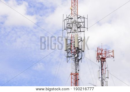 Telecommunication or Antenna tower building with the blue sky.The telecommunication concept.