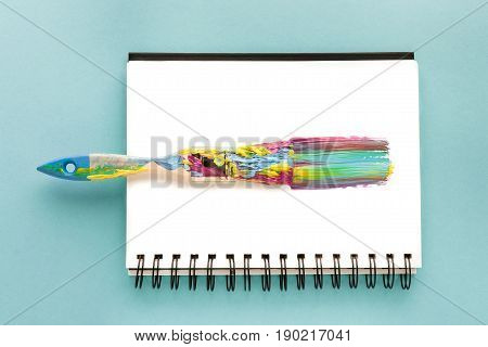 Top View Of Brush And Colorful Brushstroke In Drawing Album