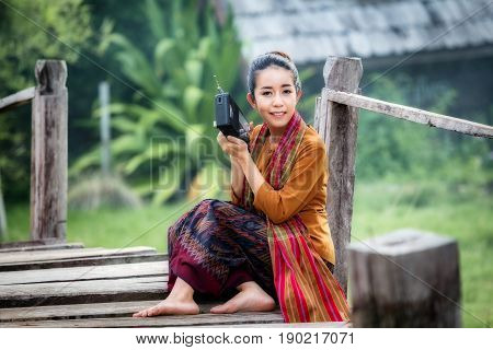 Thailand young beautiful woman listen to transistor radio a have happiness joyful