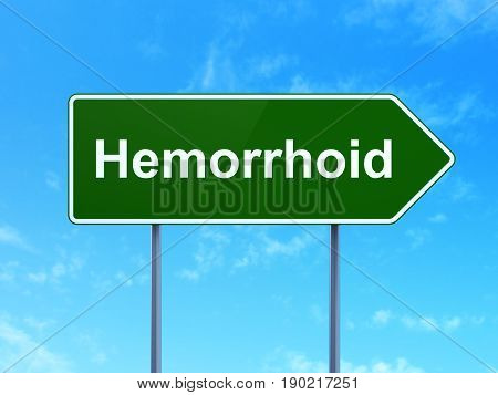 Healthcare concept: Hemorrhoid on green road highway sign, clear blue sky background, 3D rendering