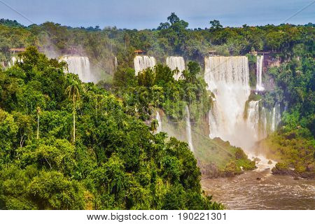 Iguazu Falls National Park - grandiose complex of waterfalls on the border of Argentina, Brazil and Paraguay. Several picturesque waterfalls. The concept of extreme and exotic tourism