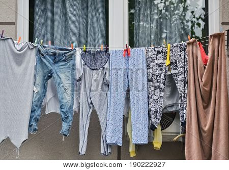 Drying laundry on a clothesline in front the windows