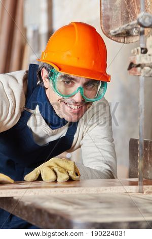 Portrait of competent carpenter processing wood