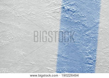 Blue line on ice hockey ground. Fragment hockey concept