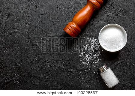 Salt In Bottle With Saltcellar For Spices Set Dark Background Top View Mockup