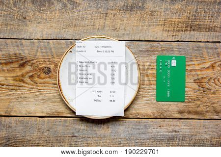 Paying Check For Lunch With Card Wooden Table Background Top View