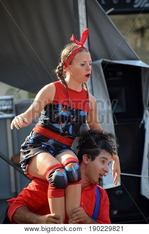ZAGREB - MAY 2017 : Cest is d`Best famous street festival with many performers on May 2017 in Zagreb. Acrobatic male and female performer  in interesting expression doing his performance play.
