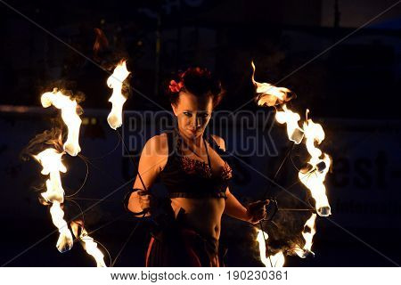 ZAGREB - MAY 2017 : Cest is d'Best famous street festival with many performers on May 2017 in Zagreb. Yanika fire performer doing her dance with fire