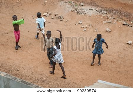 African children playing in the street. Daloa, Ivory Coast, West Africa, July 2013. Cote d'Ivoire people stock image.