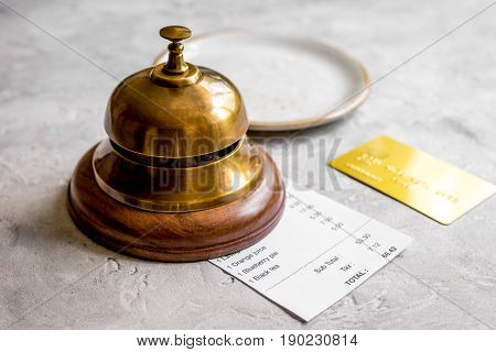 Credit Card For Paying, Waiter Ring And Check On Cafe Stone Desk Background