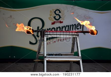 ZAGREB - MAY 2017 : Cest is d`Best famous street festival with many performers on May 2017 in Zagreb. Juggling torch with Staropramen beer commercial in the background