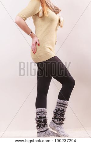 Winter fashion. Woman legs in black pantyhose and stylish fashionable woolen warm socks