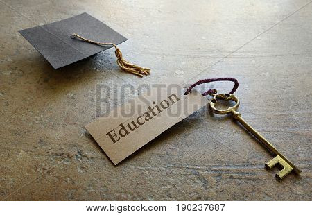 Mini graduation cap and old fashioned key with Education tag