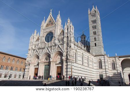 Italy Siena - December 26 2016: the view of Duomo di Siena or Metropolitan Cathedral of Santa Maria Assunta in a sunny day on December 26 2016 in Siena Tuscany Italy.