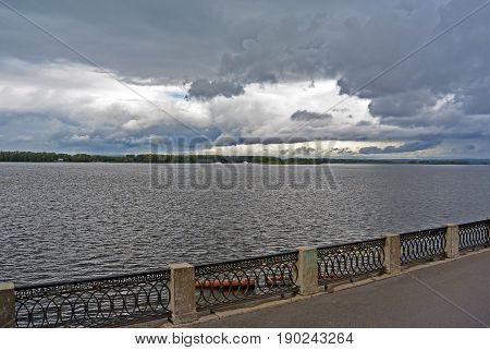 View on the Volga quay of the Samara city in anticipation of thunderstorm. City embankment before rain at cloudy autumn day