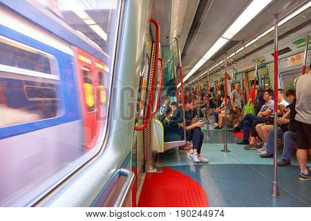 HONG KONG - SEPTEMBER 02, 2016: inside an MTR train on the East Rail Line. The East Rail Line is one of eleven railway lines of the Mass Transit Railway (MTR) system in Hong Kong