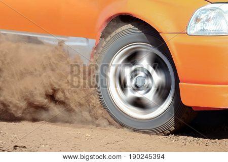 Rally Car turning in dirt track,dust splash