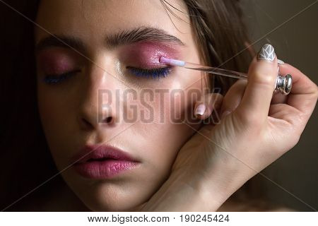 Woman Getting Rosy Shadows, Makeup, Applied On Eyes