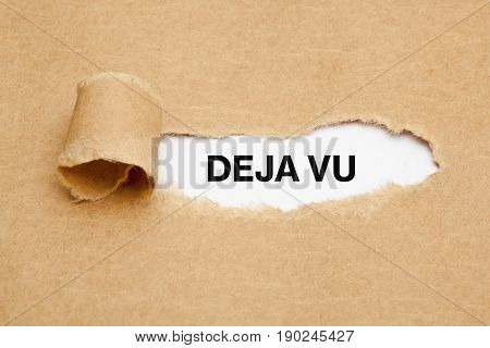 Text Deja Vu appearing behind torn brown paper.