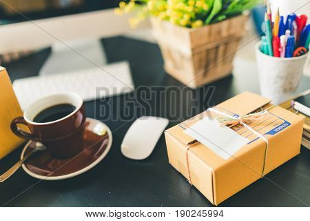 Working desk of home business startup. SME e-commerce packaging delivery online marketing or freelance concept