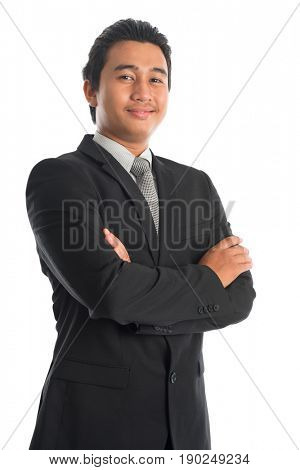Portrait of attractive young Southeast Asian businessman arms crossed standing isolated on white background. Asian Malay male model.