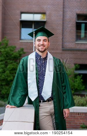 College student graduation lifestyle portrait on campus at a university.