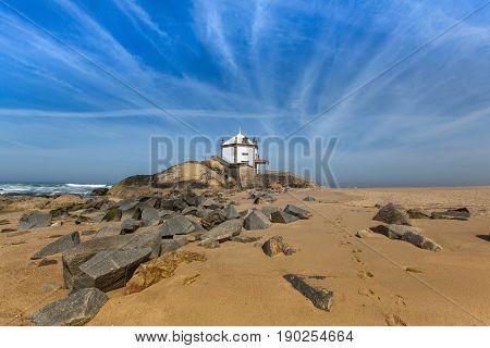 Miramar Beach and Chapel Senhor da Pedra, Atlantic ocean near Porto, Portugal.