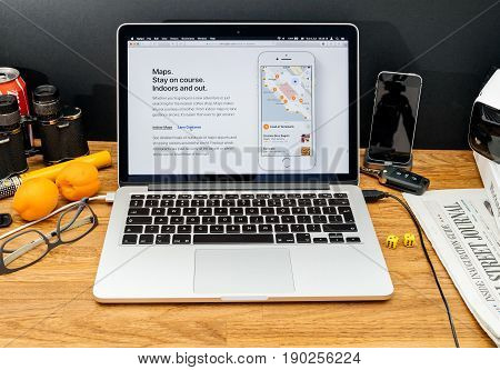 PARIS FRANCE - JUNE 6 2017: Apple Computers website on MacBook Retina in creative environment showcasing latest news from Apple at WWDC 2017 - new maps in ios 11
