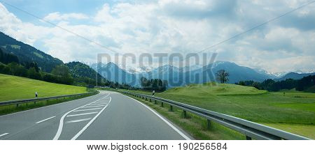 country road to the allgau alps upper bavaria