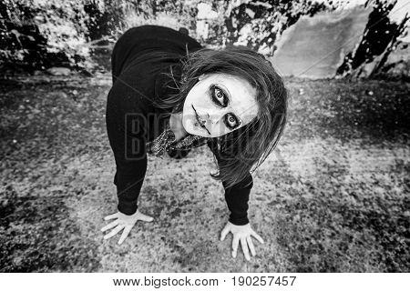 Crazy psycho girl on city street detail