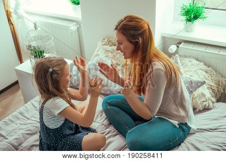 play clapping hands together with mum