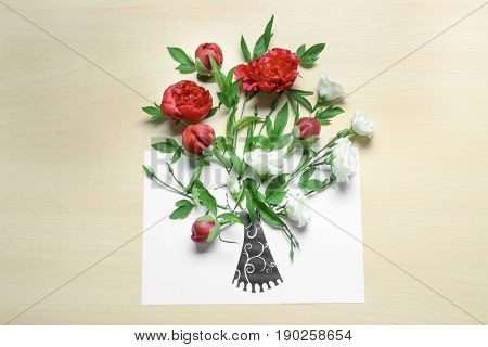 Composition of beautiful flowers and drawn tree bole on paper. Creativity concept