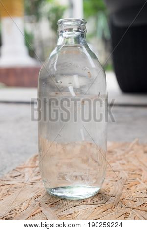 close up shot of bottle glass of soda or water