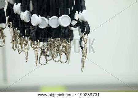 Black lanyard cord with chrome metal hook for employee card