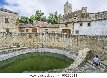 View of historic cistern in Trujillo old town Spain. Old way of storing water called alberca