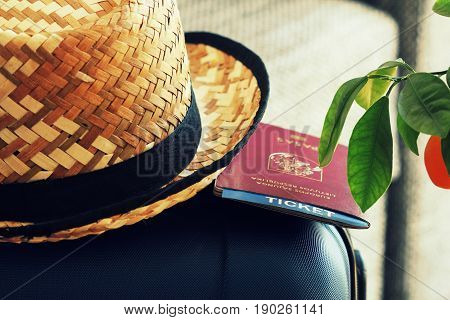 Traveling background. Suitcase and tourist stuff ready for travel .