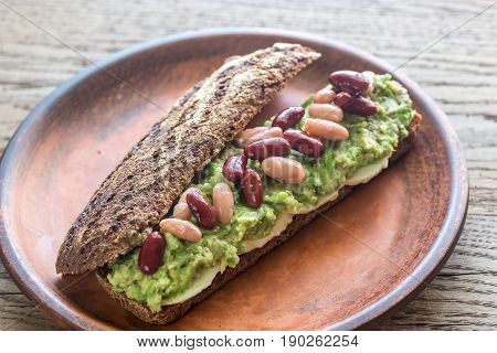 Sandwich With Smashed Avocado And Kidney Beans
